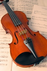 http://www.dreamstime.com/royalty-free-stock-photo-violin-over-music-scores-image8393175